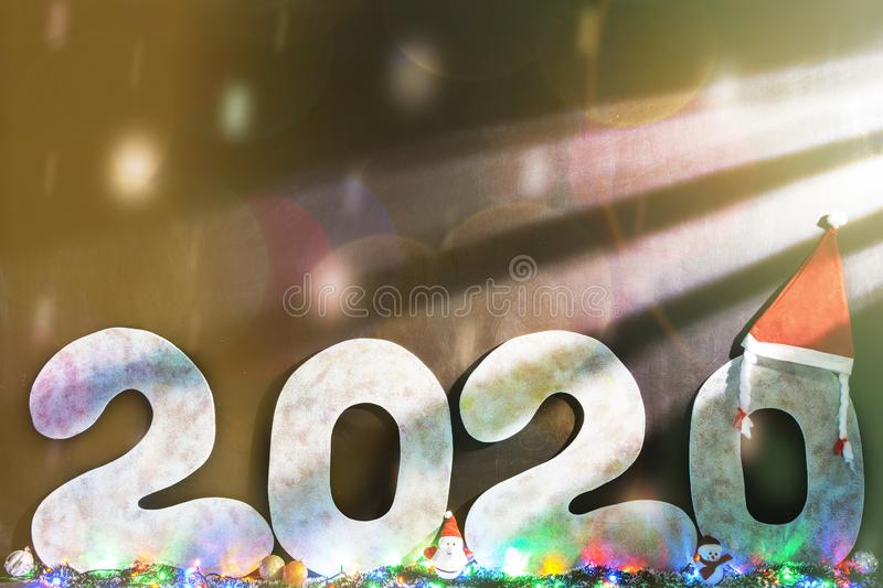 Happy new year 2020 isolated on black background with copy space for text, for holiday card. Blurred snowflakes, snow.  royalty free stock images