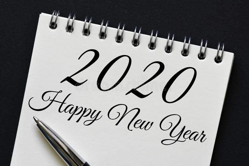 Happy New Year message. A close up of a Happy New Year 2020 message on a piece of paper with a pen stock photography