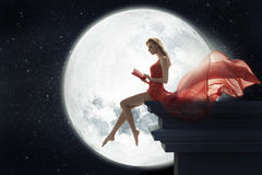 Cute woman over full moon background Stock Image